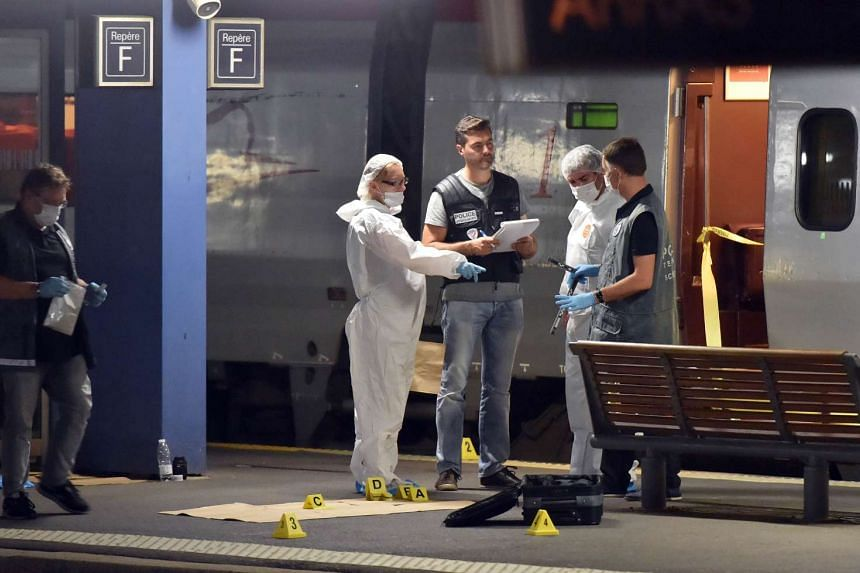 Police working on a platform next to a Thalys train of French national railway operator SNCF on Aug 21, 2015.