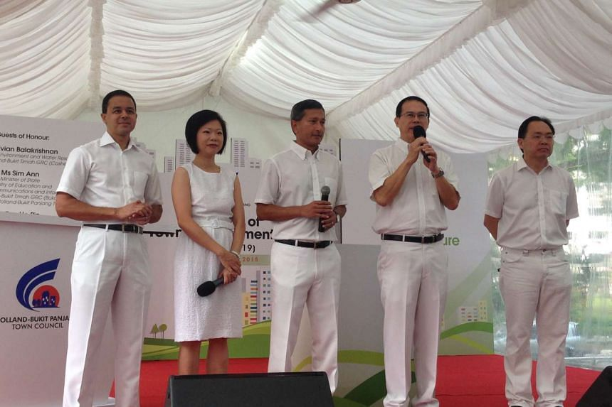 Dr Teo Ho Pin (second from right), MP for Bukit Panjang SMC, addressing residents in Bukit Panjang on Saturday, Aug22, 2015. With him are MPs for Holland-Bukit Timah GRC (from left) Christopher de Souza, Sim Ann, Vivian Balakrishnan and Liang Eng Hwa
