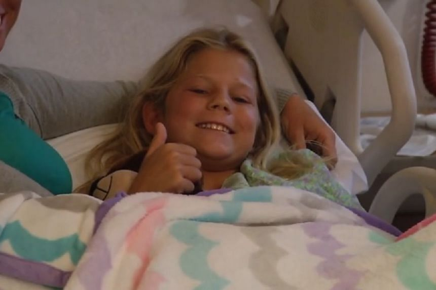 Kaley Szarmack is seen recovering in hospital in a TV news screenshot.