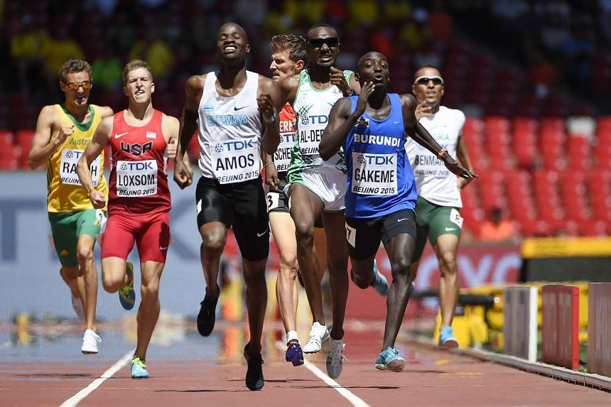 Botswana's Nijel Amos (centre) and Burundi's Antoine Gakeme (right) competing in the heats of the men's 800m athletics event at the 2015 IAAF World Championships on August 22, 2015.