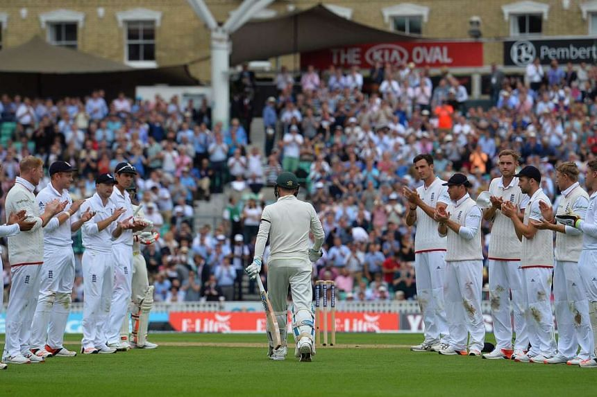 """The England team form a guard of honour, applauding Australian captain Michael Clarke as he walks to the crease at The Oval on Thursday in his final Test match. Clarke, who said there are """"no fairy tales in cricket"""", has struggled for runs during thi"""