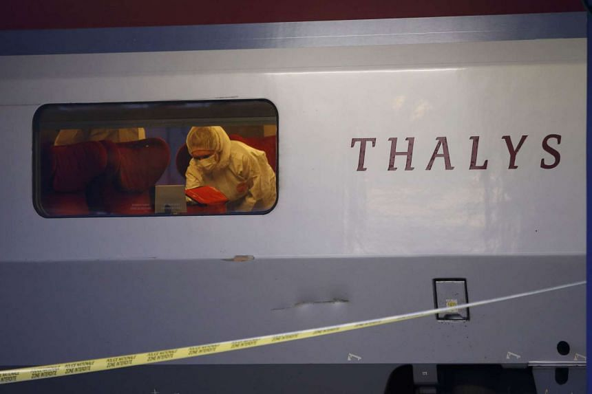 French police in protective clothing collect clues inside the Thalys high-speed train where shots were fired.