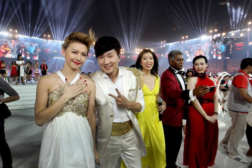 Stefanie Sun (left), JJ Lin (second from left) and Kit Chan (right) at this year's National Day Parade.