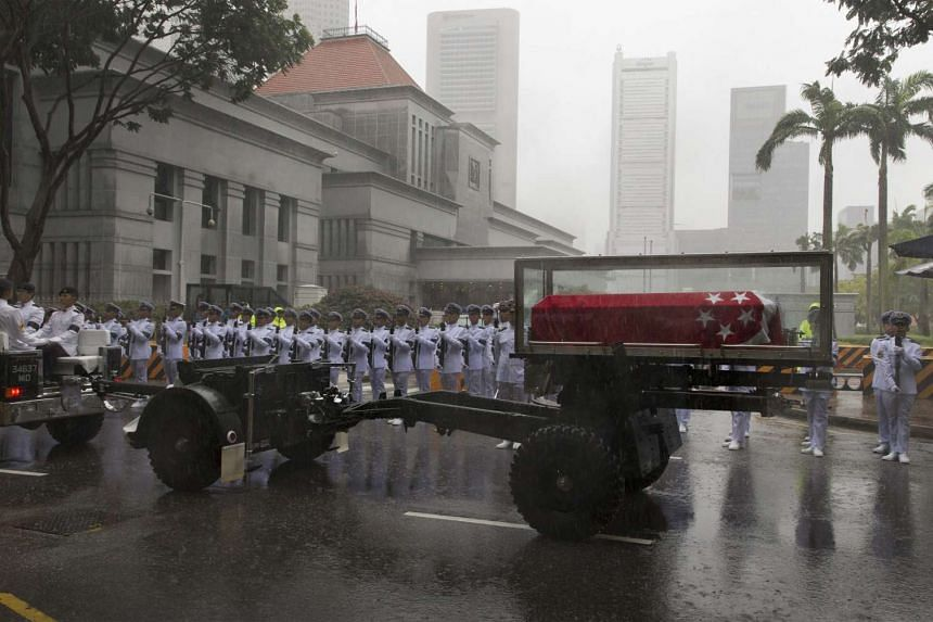 The body of former prime minister Lee Kuan Yew leaving Parliament in the ceremonial gun carriage during his funeral procession.