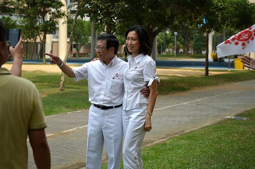 The political career of one of Singapore's longest-serving ministers, Mr Mah Bow Tan (left), has drawn to a close, after he passed the baton yesterday to his successors in Tampines GRC.
