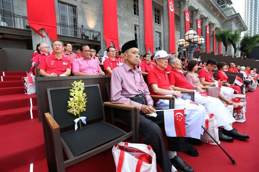 (From left) Mr Othman Wok, Mr Jek Yeun Thong and Mr Ong Pang Boon, three former ministers who signed Singapore's separation agreement, at the National Day Parade at the Padang on Aug 9, 2015. They are sitting next to a chair left empty in honour of f