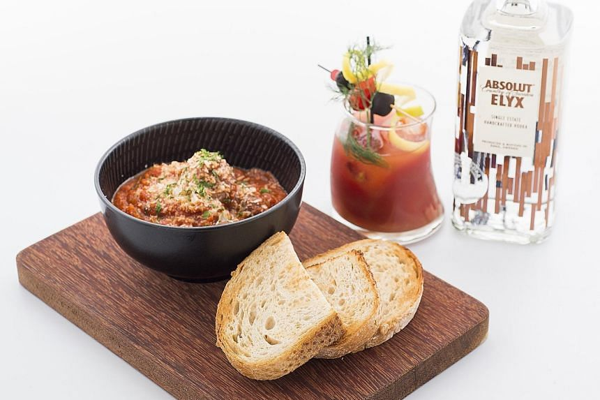 The Disgruntled Chef's Foie Gras Ricotta Beef Meatballs in tomato ragout, paired with a Kyoho Mary, which is the restaurant's spin on the traditional Bloody Mary cocktail.