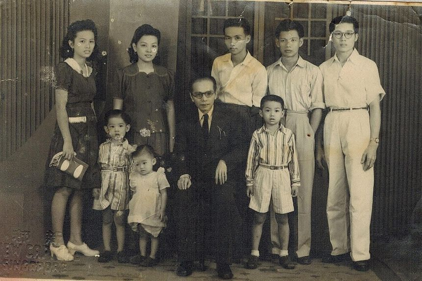Madam Teo Buck Lang, 90, is carrying on her father's work at Sin Tong Kok. The Teo family, with patriarch Teo Peck Hiang seated in the centre and Madam Teo Buck Lang (second from left) and her husband, Mr Tan Wee Seng (far right).