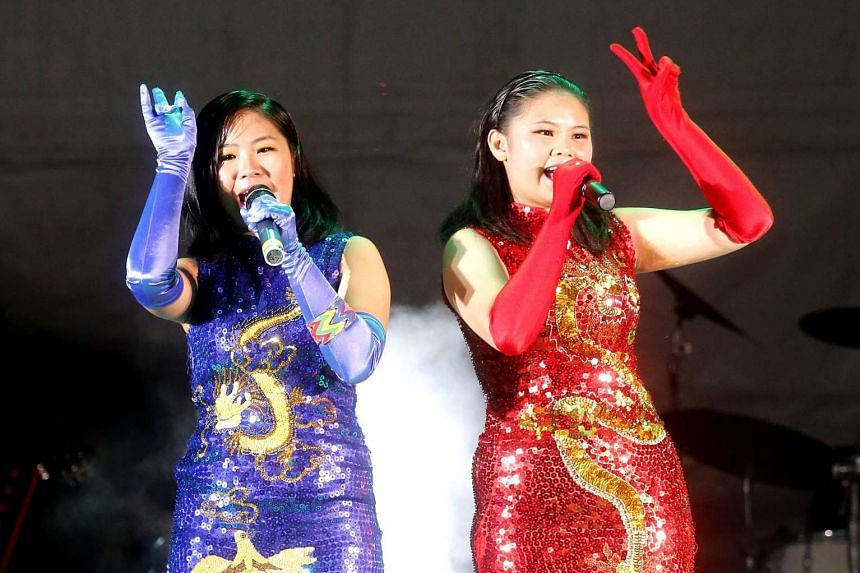 Singaporean sisters Susan (left) and Regina Yeo (far left) take on the competition by playing musical instruments during their shows. Malaysian acts, such as Sun Cola (top), 18, and Fang Fun (above), 50, are known to jazz up their shows with dazzling