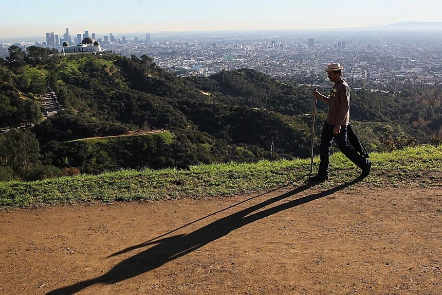 Take in the view of sunny Los Angeles from Mount Hollywood trail near the Griffith Observatory. Beatrice Ding (above) recommends the observatory for viewing the LA skyline.