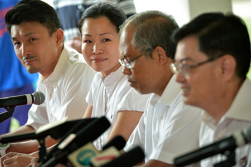 In the Tampines GRC lineup, (from left) Mr Baey Yam Keng, Ms Cheng Li Hui, Mr Masagos Zulkifli and Mr Heng Swee Keat. PAP named Ms Cheng and Mr Desmond Choo (not in picture) yesterday as the new candidates for this GRC.