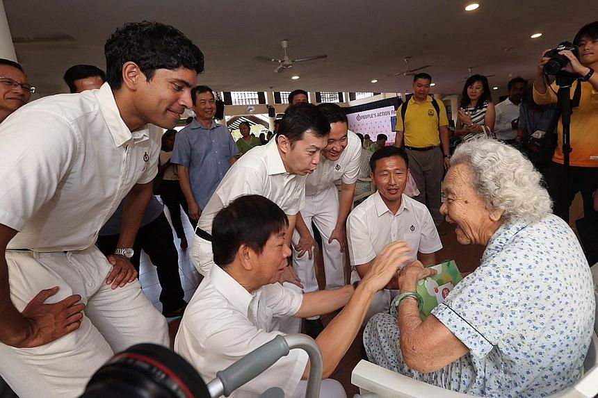 PAP's Sembawang GRC candidates (from left) Vikram Nair, Khaw Boon Wan, Lim Wee Kiak, Amrin Amin and Ong Ye Kung at Sembawang's Swami Home for the elderly needy. Mr Amrin is a newcomer, while Mr Ong was part of the Aljunied GRC team in 2011 that lost.