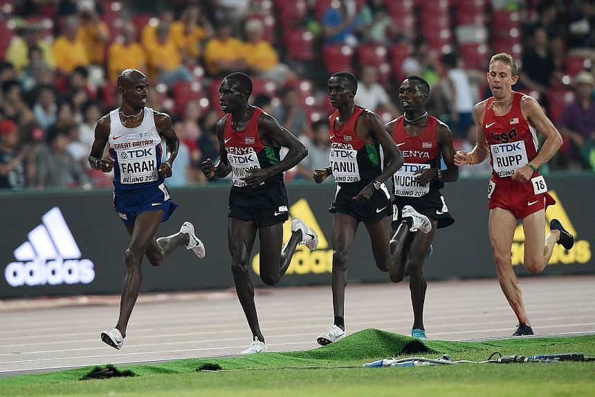Britain's Mo Farah (left) on his way to an emphatic victory in the 10,000m at the IAAF World Championships at Beijing's Bird's Nest stadium last night.