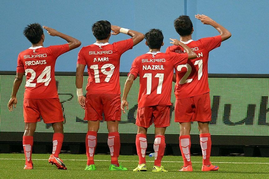 LionsXII players saluting fans after Khairul Amri converted for the side's second goal in the 3-0 MSL victory against Sime Darby at the Jalan Besar Stadium last night.