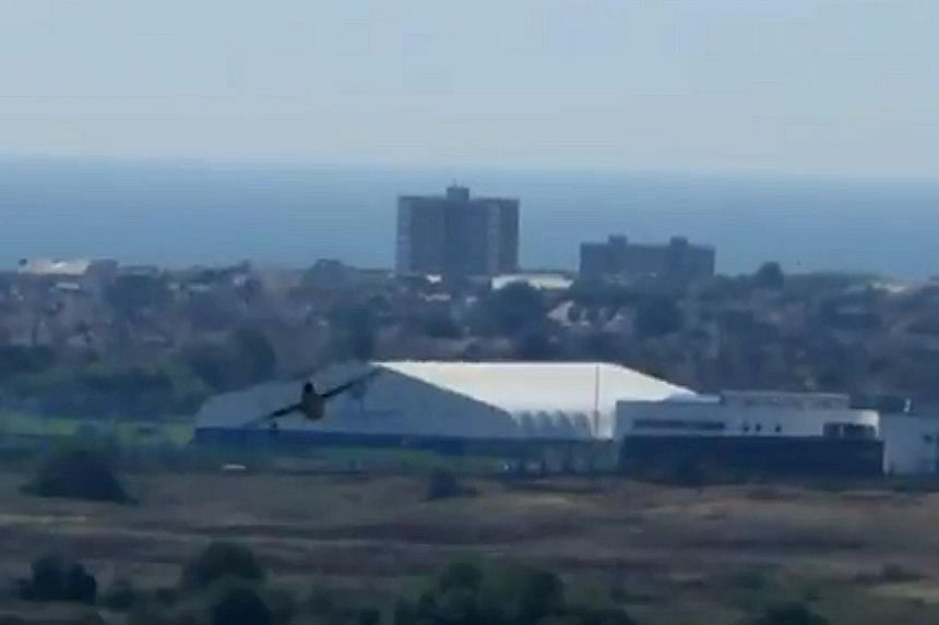 YouTube images show the plane at the Shoreham Air Show before it crashed and the fiery aftermath. Reports say the pilot was pulled from the burning wreckage.