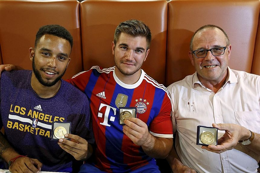 (From left) Americans Anthony Sadler and Alek Skarlatos and Briton Chris Norman showing the medals they received for bravery, when they helped disarm a gunman on a train from Amsterdam to France.