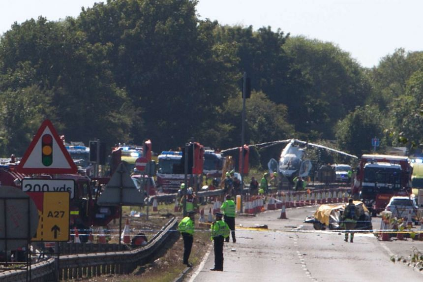 Police and members of the emergency services work at the scene of the crash.