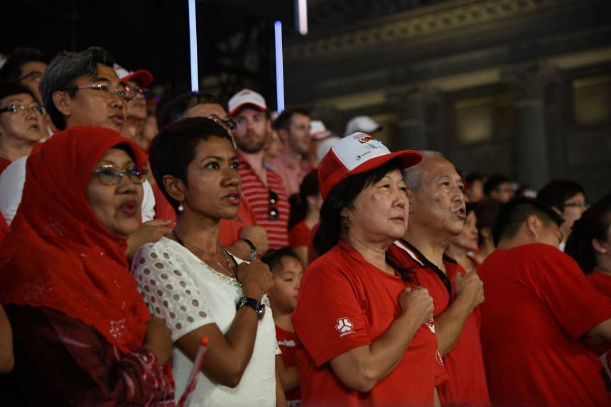 Singaporeans taking the Pledge during the National Day Parade at the Padang on Aug 9, 2015.
