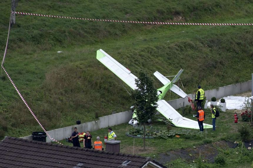 A small plane on the ground at the scene of a crash in Dittingen, Switzerland on Aug 23, 2015.