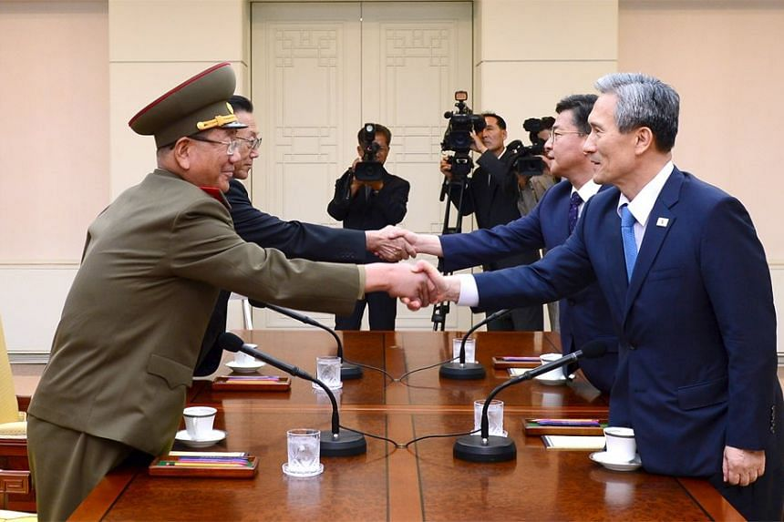(From right) South Korea's National Security Adviser Kim Kwan Jin and Unification Minister Hong Yong Pyo, and North Korea's Secretary of the Central Committee of the Workers' Party Kim Yang Gon and senior military official Hwang Pyong So shake hands