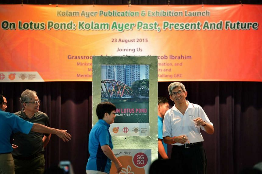 Minister for Information, Communications and the Arts Yaacob Ibrahim launching a book on the history of Kolam Ayer at Kolam Ayer Community Club on Sunday, Aug 23, 2015.