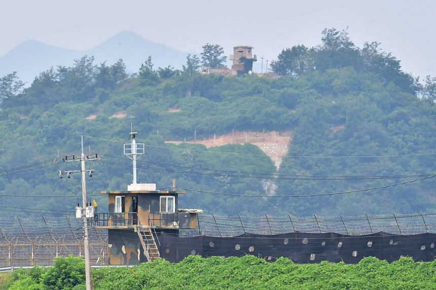 Military guard posts of South Korea (bottom) and North Korea (top) stand opposite each other as seen from in the border city of Paju on Aug 21, 2015.