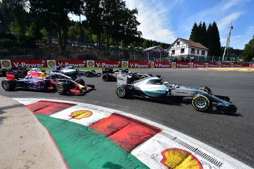 Mercedes AMG Petronas F1 Team's British driver Lewis Hamilton (R) leads during the 2015 Belgium Formula One Grand Prix at the Spa-Francorchamps race track near Francorchamps, Belgium on Aug 23, 2015.