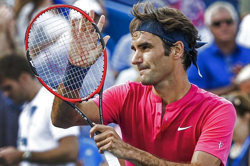 Roger Federer celebrates his win over Andy Murray in their semi-final round match.