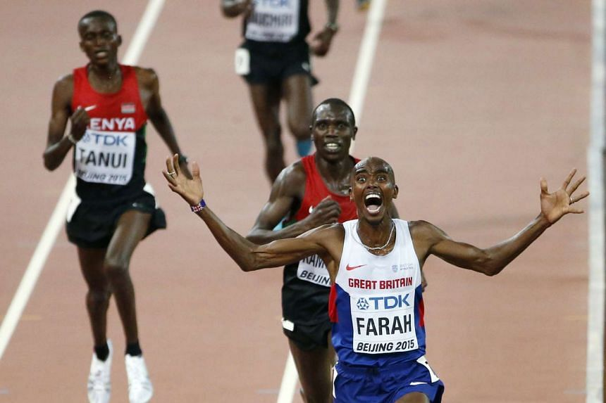 Mo Farah crossing the finishing line in first place for the 10,000m race at the world championships in Beijing.