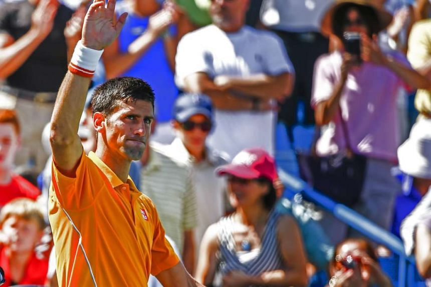 Novak Djokovic waves after defeating Alexander Dolgopolov in their semifinal round match in the Western & Southern Open at the Linder Family Tennis Center in Mason, Ohio, USA on Aug 22, 2015.