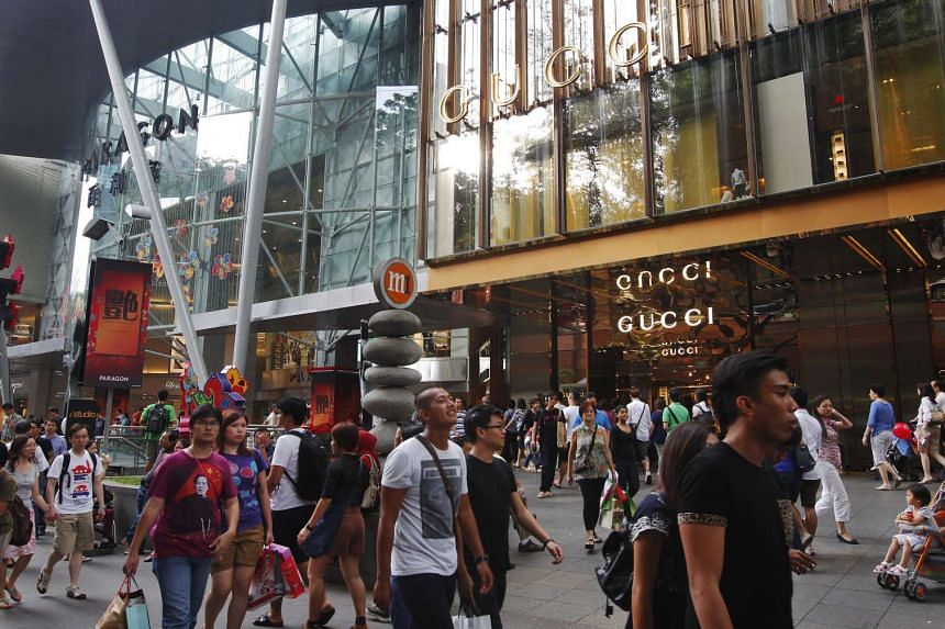 Shoppers in front of Paragon at Orchard Road.