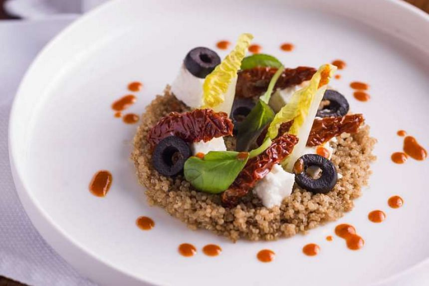 Balzac Brasserie's executive chef Jean-Charles Dubois serves up dishes such as Anjou quinoa salad, black olives, pimento, sun-dried tomatoes, feta cheese and carrot dressing (above).