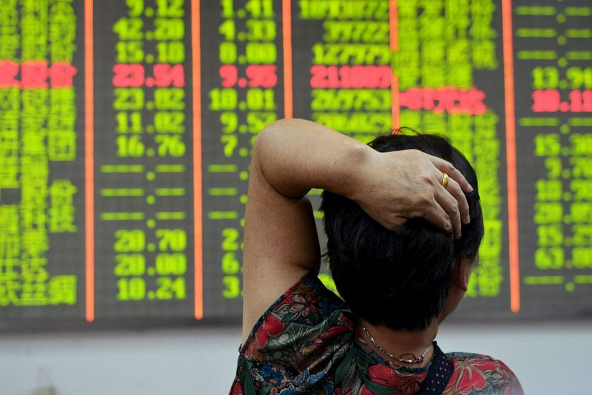 An electronic board showing stock information at a brokerage in Hangzhou, Zhejiang province, last Tuesday. China shares listed in Hong Kong have been belted, given Beijing's unexpected decision to devalue the yuan.