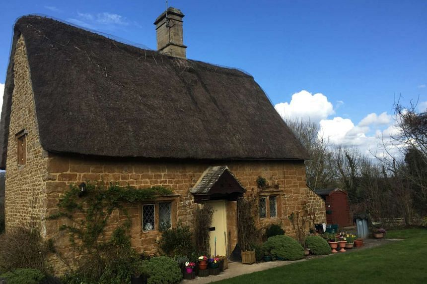 Above: A charming thatched cottage in the sleepy hamlet of Great Tew.