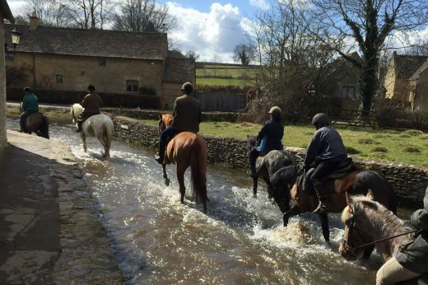 Horseback riders crossing a section of the River Eye in Lower Slaughter (above).