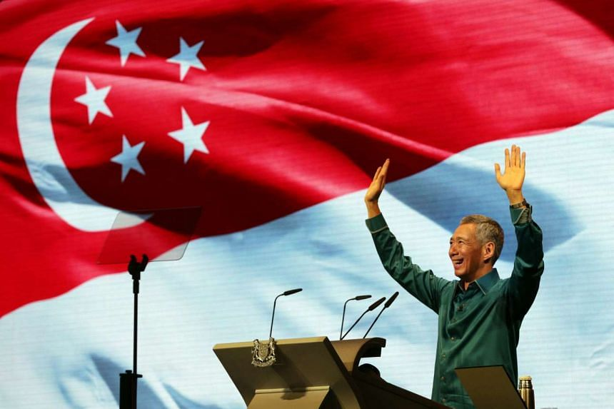 Prime Minister Lee Hsien Loong waving to the audience after his National Day Rally speech last year. The SG50 Rally tonight is an apt platform to reflect on Singapore's success and unite the nation for the road ahead.