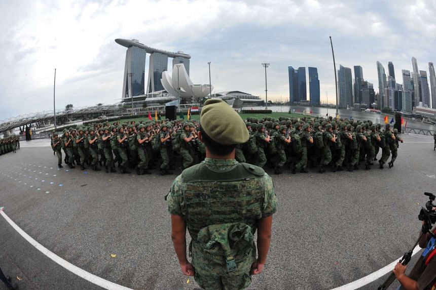 A passing-out parade at the Floating Platform in Marina Bay. Not only do two years of training as a soldier make a young man physically and mentally resilient (not to mention attractive), it is also a crucial rite of passage that marks the life of a Singa