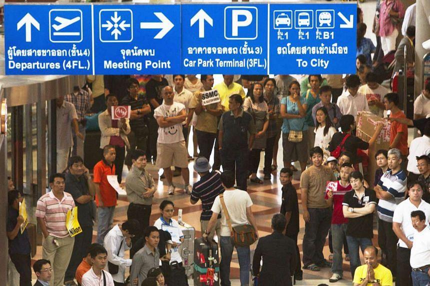 People at the arrival hall at Suvarnabhumi Airport in Bangkok, Thailand, on May 8, 2011.