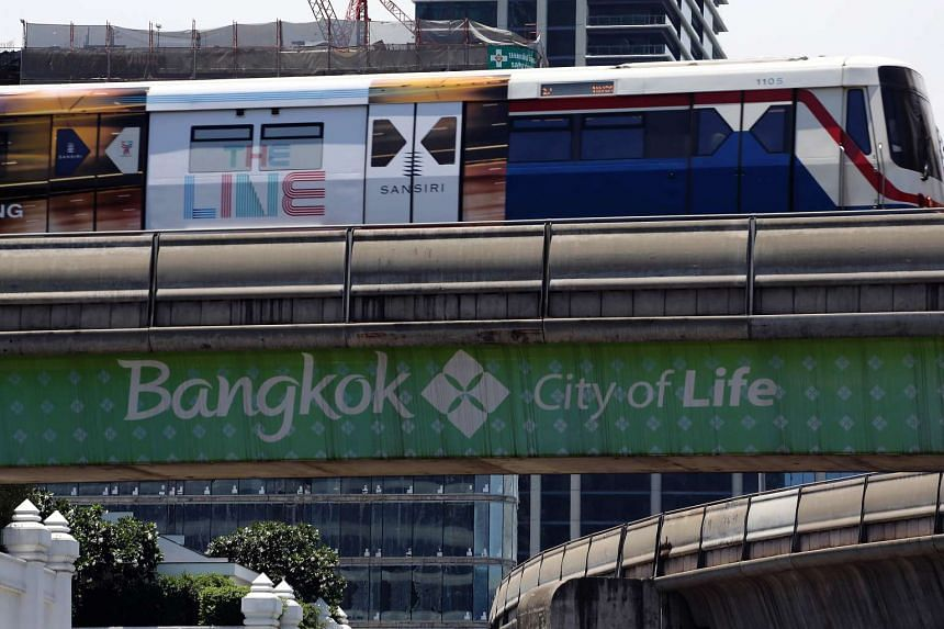 A Bangkok Mass Transit System Pcl (BTS) SkyTrain travels past a banner promoting the city of Bangkok on Aug 18, 2015.