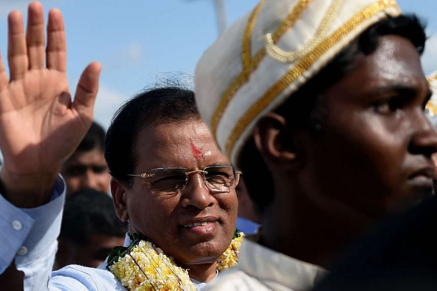 Sri Lankan President Maithripala Sirisena (left) arrives in the eastern town of Muttur on Aug 22, 2015.