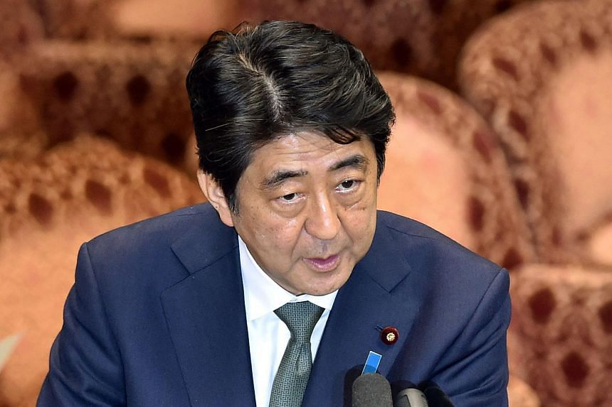 Shinzo Abe speaks during a special committee session in the upper house of parliament in Tokyo on Aug 21, 2015.
