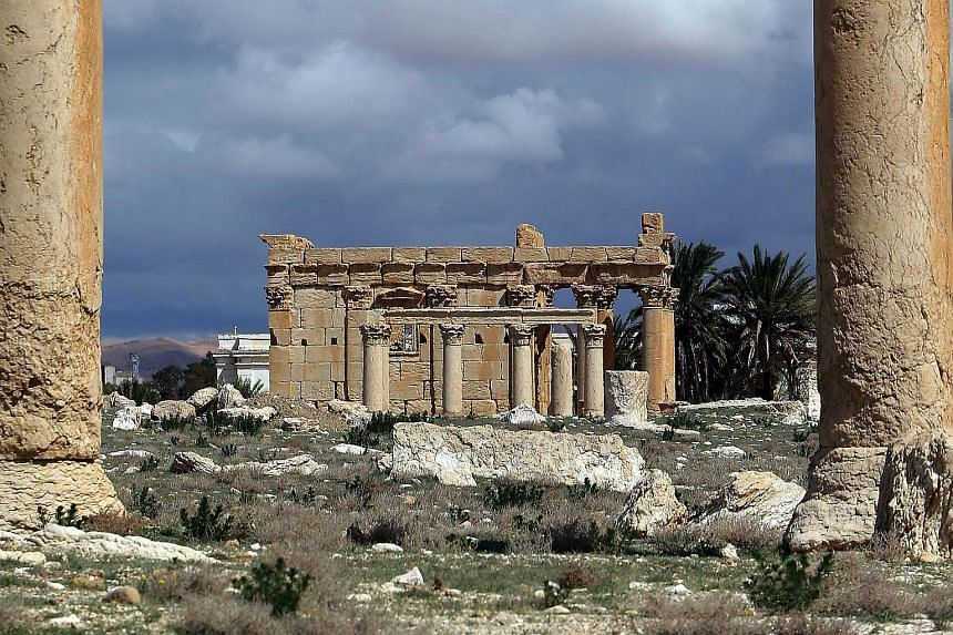 A picture taken on March 14, 2014 shows the Temple of Baal Shamin seen through two Corinthian columns in the ancient oasis city of Palmyra, 215 kilometres northeast of Damascus.