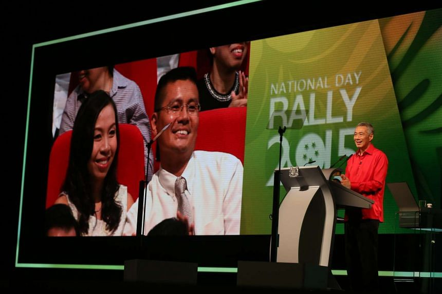 PM Lee Hsien Loong speaking about a couple who had five children at the National Day Rally at ITE College Central on Aug 23, 2015. They were in the audience.