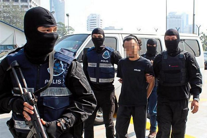 A man believed to be a member of ISIS being detained by Malaysian police for planned attacks in the Klang Valley. So far, 121 Malaysians have been arrested for suspected links with ISIS.