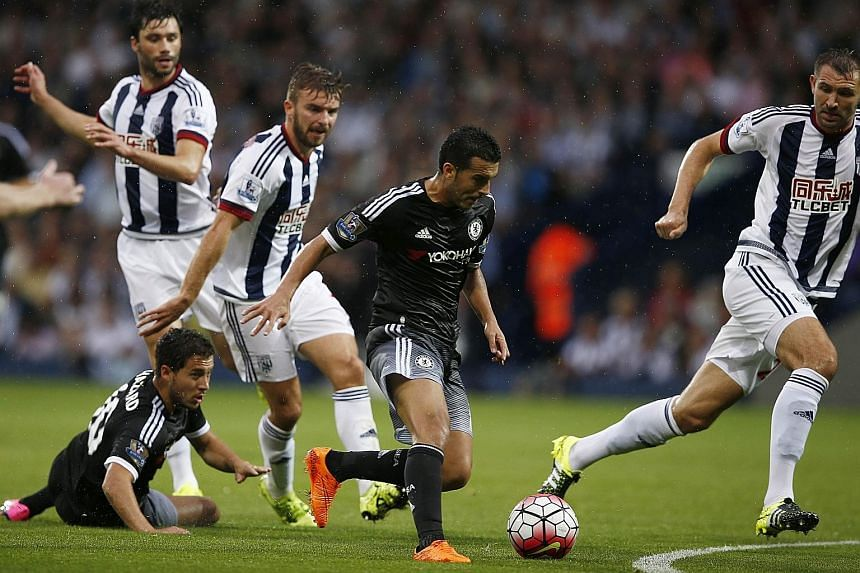 Pedro (centre) running with the ball in the build-up to scoring the opening goal. The Spaniard has now scored as many league goals as Manchester United's players combined this EPL season. United had pulled out from signing him.