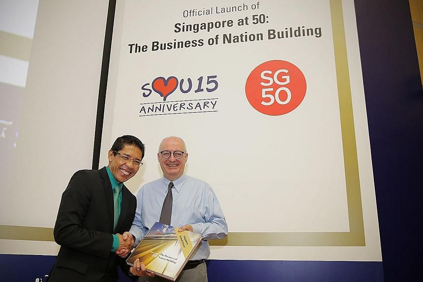 Professor Arnoud De Meyer (right), SMU president, presenting a copy of the book to Dr Mohamad Maliki Osman, Minister of State for National Development and Defence, and Mayor, South East District, last Friday.
