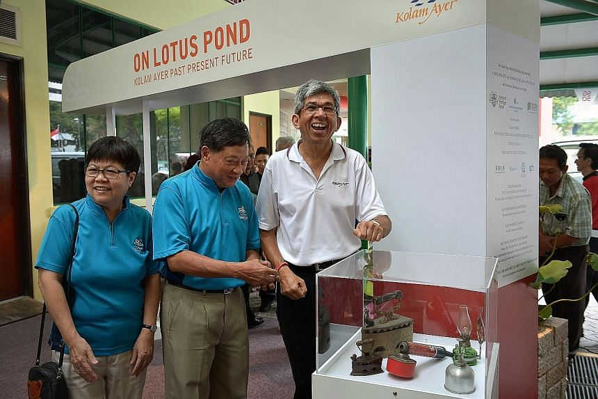 Dr Yaacob Ibrahim (right) at the exhibition at Kolam Ayer CC, along with Mrs Kiang-Koh Lai Lin, 64, who chairs the committee behind the book (below) and exhibition. With them is Mr Leong Sing Wee, 63, SG50 Kolam Ayer committee chairman.
