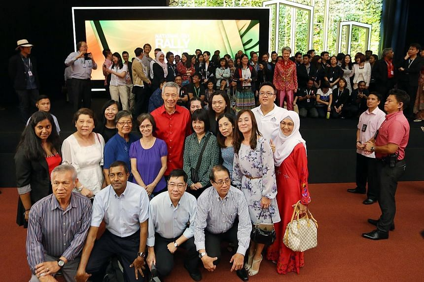 Prime Minister Lee Hsien Loong having a photo taken with a group of people who attended his SG50 National Day Rally at ITE Central last night.