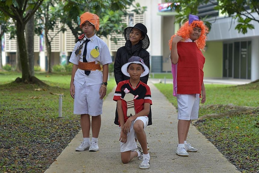 """The team from Yuying Secondary School - (foreground) Afiq Khan and (back row, from left) Leonard Yap Boon How, Firdayini Nasihah Afendi and Ian Tan Wen Yi- portraying characters from Roald Dahl's novel James And The Giant Peach in the festival's """"Boo"""