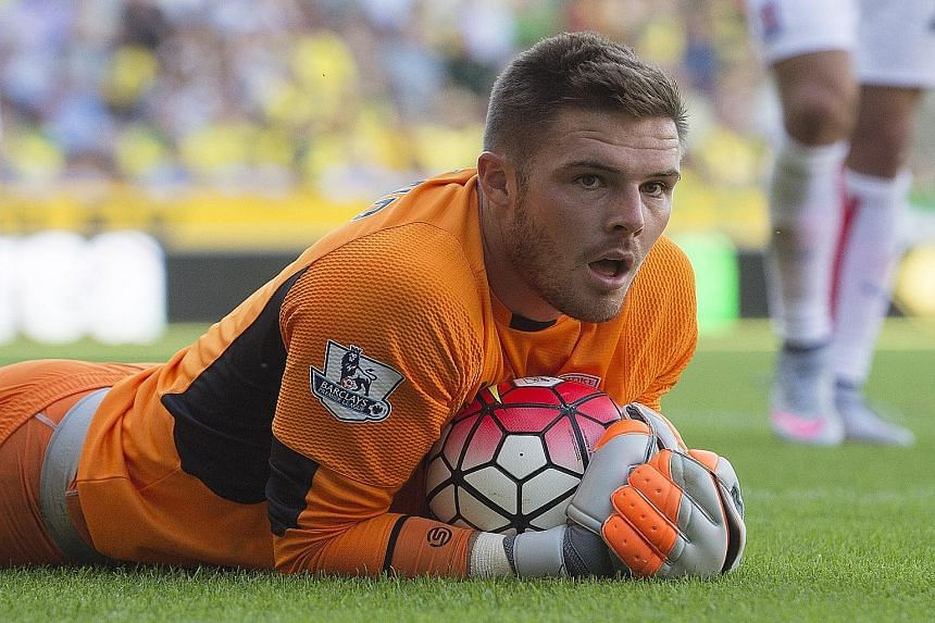 Jack Butland keeping the ball safe in his grasp. The Stoke goalkeeper played through the pain barrier in his side's 1-1 draw at Norwich.